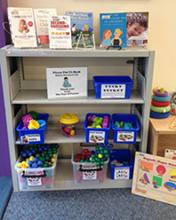 Image of new parent's resource shelf